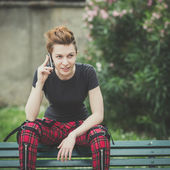 Young lesbian stylish hair style woman using smart phone — Stock Photo