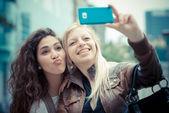 Blonde and brunette beautiful stylish young women — Stock Photo