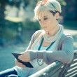 Beautiful young blonde short hair hipster woman using tablet — Stock Photo #48762023