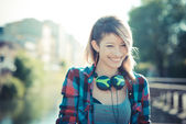 Young beautiful model woman listening music — Stock Photo