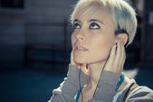 Hipster woman listening music — Stock Photo