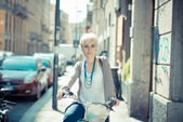 Hipster woman with bike — Stock Photo