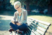 Hipster woman using tablet — Stock Photo
