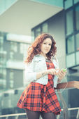 Curly  hipster woman  listening music — Stock Photo