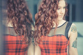 Woman with red curly hair — Stock Photo
