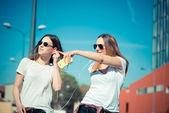 Two beautiful young women walking — Foto de Stock