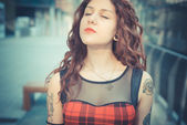 Young beautiful hipster woman with red curly hair — Foto de Stock
