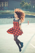 Young beautiful hipster woman with red curly hair — Stock Photo