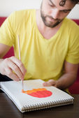 Hipster modern man painting — Stock Photo