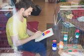Modern man painting — Stock Photo