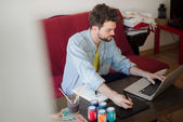 Man working home using laptop — Stock Photo