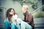 Young women using smart phone — Stock Photo