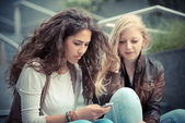 Women using smart phone — Stock Photo