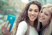 Stylish young women selfie — Stockfoto