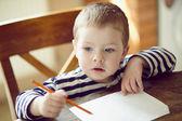 Boy draws — Stock Photo