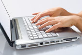 Hands of woman typing on the laptop — Stok fotoğraf