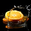 Citrus fruits in water — Stock Photo #38010471