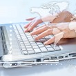 Hands of woman typing on the laptop — Stock Photo #40671121