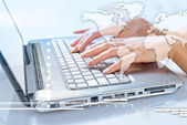 Hands of woman typing on the laptop — Stockfoto