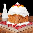 Christmas cake and white candle — Stock Photo