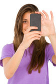 Teenage girl with smartphone — Stock Photo