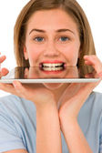 Teenage girl with tablet in mouth — Stock Photo