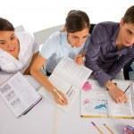 Teenagers in classroom — Stock Photo