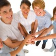 Teenagers with hands together — Stockfoto