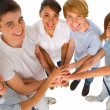 Teenagers with hands together — Stock Photo