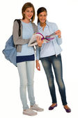 Teenage girls with backpack and books — Stock Photo