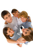 Group of teenagers in huddle — Stock Photo