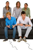 Teenagers playing with playstation — Stock Photo