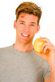 Young man holding an apple — Stock Photo