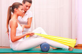 Exercises with elastic strengthening tibial tarsal — Stock Photo