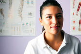Young woman portrait physiotherapist — Stock Photo