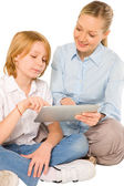 Mother and son sat on floor with tablet isolated on white backgr — Stock Photo