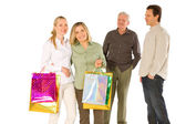 Family with shopping bag isolated on white background — Stock Photo