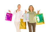 Women mother and doughter carring shopping bags isolated on whit — Stock Photo