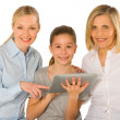 Family using pc tablet — Stock Photo