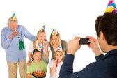Family celebrating birthday party with cake — Stock Photo
