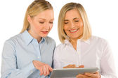 Two women using tablet — Stock Photo