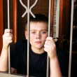 Stock Photo: Young Boy Locked Inside House for Protection