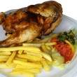 Isolated Half Chicken and Fries Close Up — Stock Photo #18865705