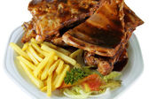 Spareribs and Fries on White Plate Close Up — Stock Photo