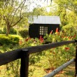 Stock Photo: Wooden Dollhouse in Garden
