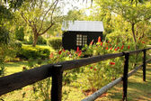 Wooden Dollhouse in Garden — Stock Photo