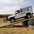 Stock Photo: White Land Rover Defender 110 HC on 4x4 Course