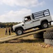 Постер, плакат: White Land Rover Defender 110 HC on 4x4 Course