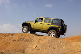 Green Jeep Wrangler Unlimited on 4x4 Course — Stock Photo