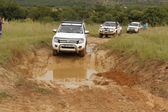 White Ford Ranger XLS with Silver Canopy crossing mud obstacle — Stock Photo
